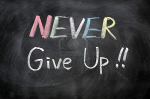 11939322-never-give-up-written-in-chalk-on-a-blackboard